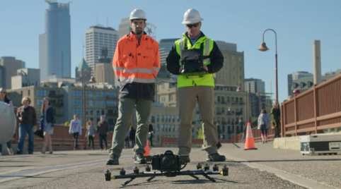 Using the Intel Falcon 8+ Drone and 36-megapixel Sony A7R payload, Intel, Collins Engineers and the Minnesota Department of Transportation conduct an aerial survey of the Stone Arch Bridge in Minneapolis. Working with the Minnesota Department of Transportation and Collins Engineers, Intel used its commercial drone technology to help automate and expedite inspection the pedestrian and bicycle bridge in Minneapolis. (Credit: Intel Corporation)