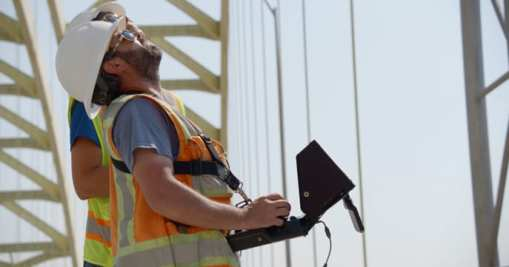 Experts from Michael Baker International using the Intel Falcon 8+ drone to aid in the inspection of the Daniel Carter Beard Bridge, which connects Ohio and Kentucky. In partnership with the Kentucky Transportation Cabinet and Michael Baker International, Intel used its drone technology to help inspect and analyze the eight-lane interstate bridge across the Ohio River. (Credit: Intel Corporation)