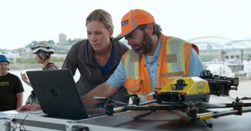 Alicia McConnell and Brian Gutzwiller from Michael Baker International plan the automated missions to inspect the Daniel Carter Beard Bridge. In partnership with the Kentucky Transportation Cabinet and Michael Baker International, Intel used its drone technology to help inspect and analyze the Daniel Carter Beard Bridge, an eight-lane interstate across the Ohio River. (Credit: Intel Corporation)