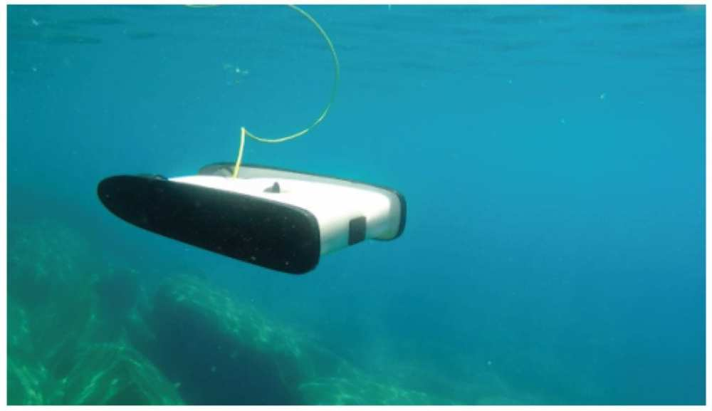 A small underwater OpenROV robot connected through a thin cable for video and control transmissions