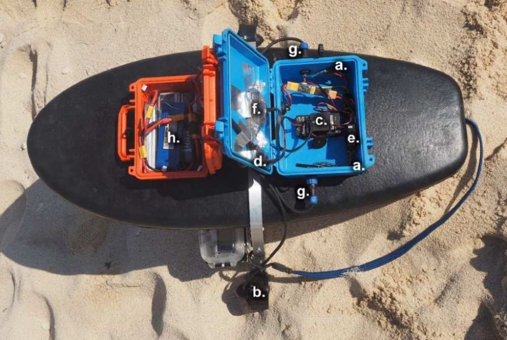 Fully assembled Reef Rover Version 2. The control unit is housed in the blue case and contains the autopilot, electronic speed controllers, radios, and Global Positioning System (GPS). The orange case contains the LiPo batteries that provide power to the control unit and electric motors. The following components are labelled in the lower image and detailed further in Table 1. (a) Blue Robotics electronic speed controllers (ESCs), (b) Blue Robotics T100 thrusters, (c) Pixhawk 1 flight controller, (d) Telemetry radio, (e) Radio and receiver for communicating with the remote controller (f) Ublox M8N GPS, (g) Waterproof panel plugs, and (h) 3 cell (11.1 volt), 5000 mAh LiPo batteries.