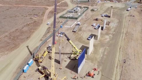 "U.S. Customs and Border Protection released b-roll video footage showing various prototypes of the border wall Trump promised during his campaign. The video is shot from a drone that flies over the various wall prototypes and like Matt Novak from Gizmodo points out: ""the drone video of border wall prototypes accidently shows how worthless the wall would be."" Trump said that the purpose of the wall was to stop: ""drugs from pouring into this country"". However, any affordable and easily obtainable consumer drone would have no problem flying over the wall to drop drugs on the other side."