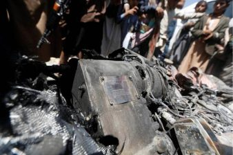 People gather around the engine of a drone aircraft which the Houthi rebels said they have downed in Sanaa, Yemen October 1, 2017. REUTERS:Khaled Abdullah 2