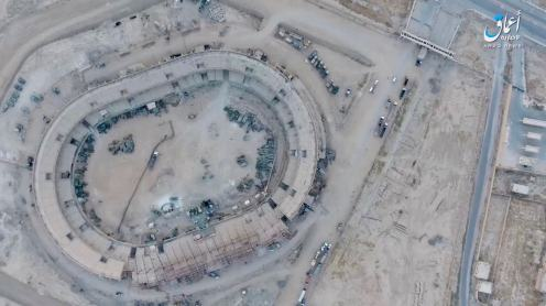 Today this video surfaced, in which ISIS uses a drone to drop a grenade at an ammunition depot west of Mayadeen, Syria and eventually blows the whole place up.