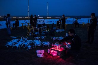 Employees of Ehang, a commercial drone maker, checking the vehicles before a light show in Wuhan. Credit Lam Yik Fei for The New York Times Photo
