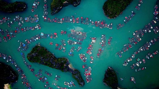 AERIAL IMAGE CAPTURED AT HA LONG BA,ONE OF THE MOST SPECTACULAR PLACE IN VIETNAM. I WAS FASCINATED BY THE FLOATING VILLAGES WHERE I SAW ACTIVITIES AND LIFE.