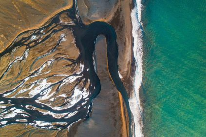 Aerial view of Glacial river meeting the ocean. I used a drone to capture this image.