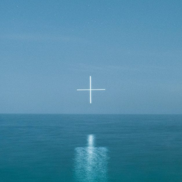 Photographer uses a drone to create glowing symbols over water 2