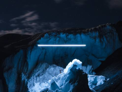 Glaciers dramatically lit up at night by a drone 5