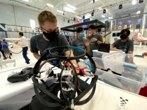 A student prepares for drone soccer