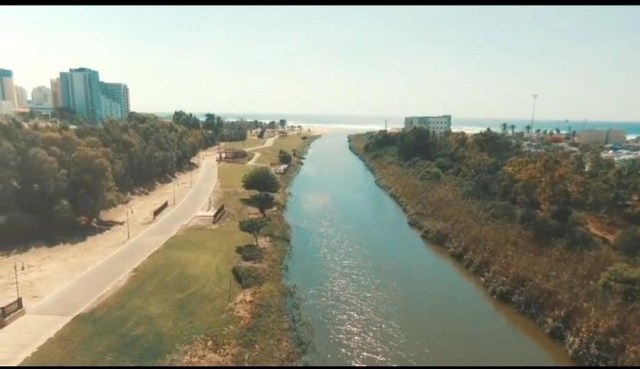 This is a photo from the drone photography bible review of the parrot bebop 1.0. The photo was taken in israel and is a canal surrounded by greenery
