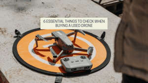 A drone and a remote on the ground. - featured image from the drone photography bible article 6 Essential Things To Check When Buying A Used Drone