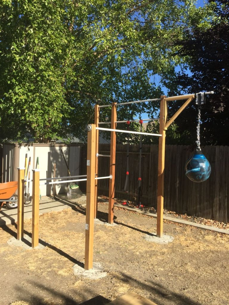 Another fixed bar garden gym which reminds me my school's climbing apparatus. with suspension straps and a hanging punch bag.