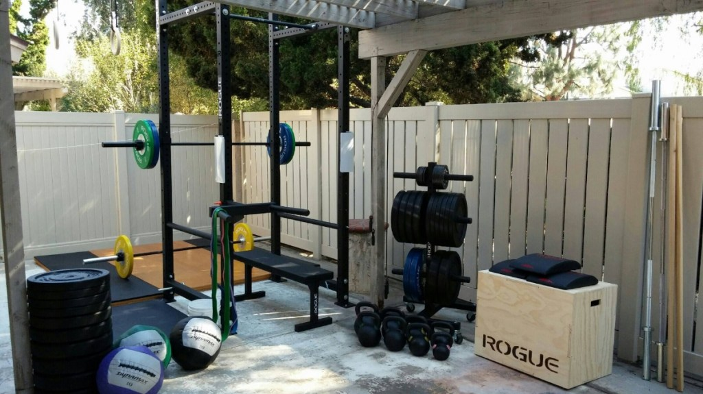 A full power cage with barbell, bench, plate tree and a LOT of plates!