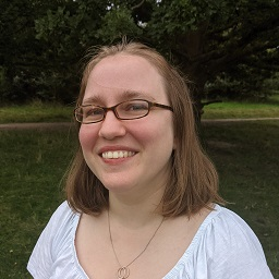 A person smiling for the camera Description automatically generated with medium confidence