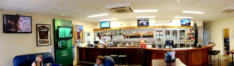 There are more t.v. screens than tables in the Dingo Hotel. 5 of the 9 screens can be seen in this picture.