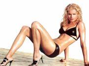 31. Rebecca Romijn