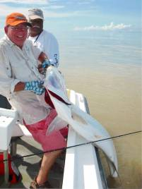 ken-dawes-holding-a-fly-caught-tarpon