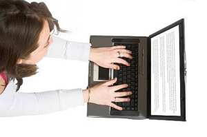 Importance of Online Writing Activities for Kids1 - casual woman browsing on laptop