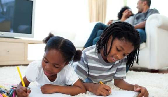 stockfresh 2313746 lively children drawing lying on the floor sizeXS1 - Helping Parents Make Sense of Educational System in America