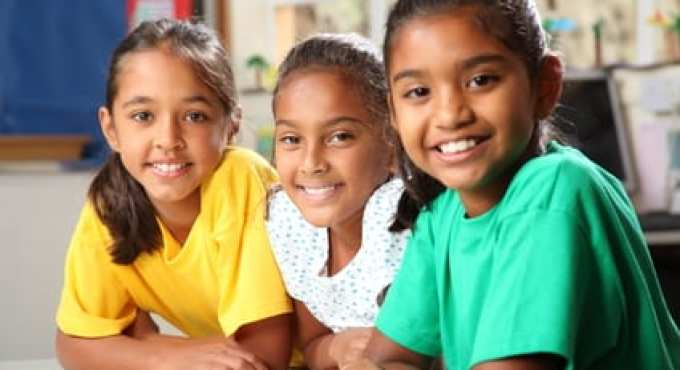 Optimized stockfresh 456257 three smiling young primary school girls sitting in class sizeXS - What Single Gender School Statistics Say About Learning