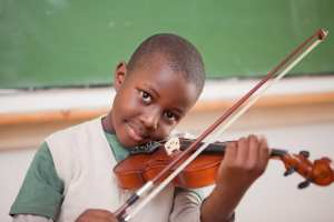 stockfresh 2583092 schoolboy playing the violin in a classroom sizeM mini - Gifted Child
