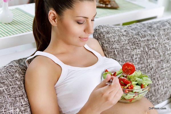 Beautiful pregnancy eating salad