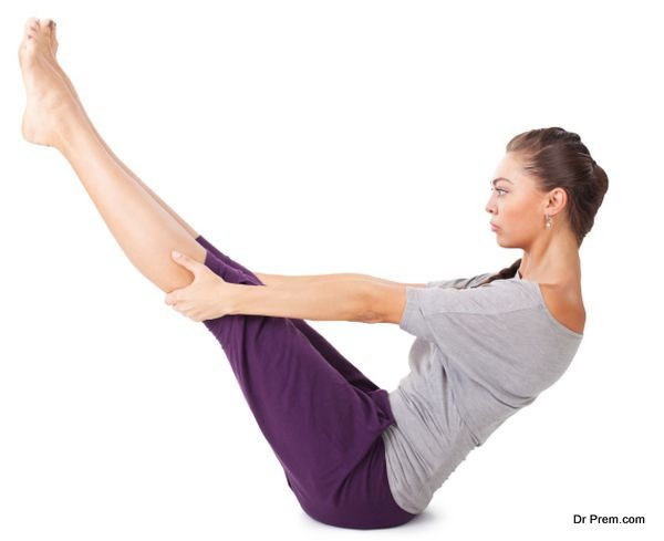 woman doing yoga exercise Full Boat Pose. Paripurna navasana