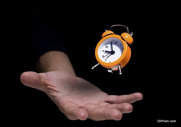 Floating clock over the humans hand.