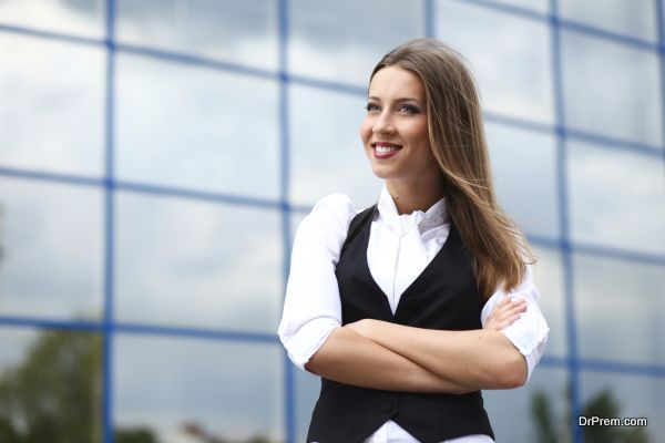 Young success businesswoman standing near office building