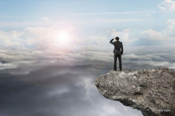 businessman looking on cliff with natural sky daylight cloudscape