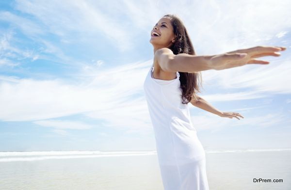 Woman with amrs out carefree healthy summer lifestyle on holiday