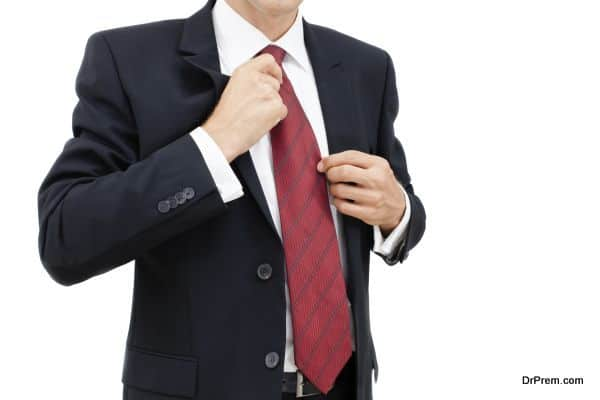 Business man getting dressed and ready for work