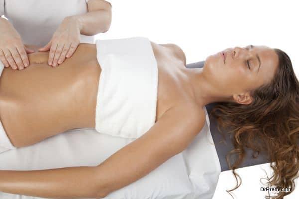 Young women having stomach massage