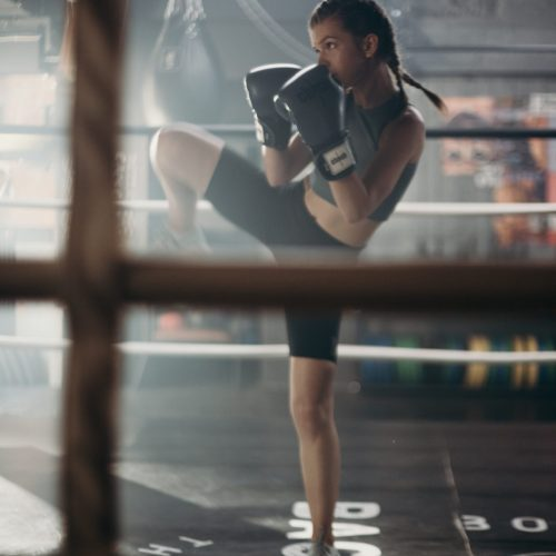 Image of women kick boxing to desplay the idea of woman being strong and taking controll of live.