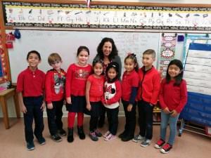 Image Mrs. Herrera with students