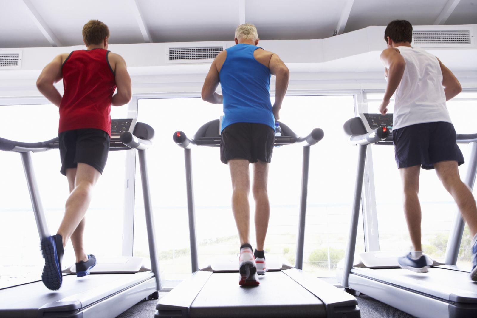 men running on treadmills