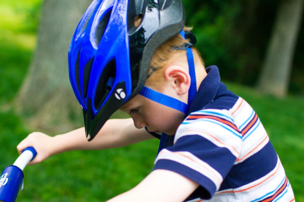 Teach a child how to ride a bike