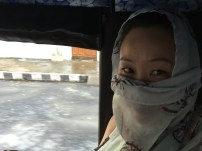 Anna in our auto trying to keep the dust out of her face. Our driver was a dick, but more on that later…
