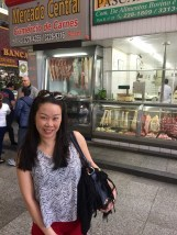 Anna in front a stall selling pig's trotters
