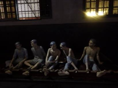 A full scale recreation of prison life showing starving prisoners in leg-irons