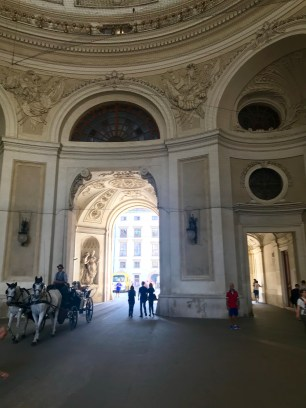 Walking through an arch in St. Michael's Wing of Hofburg Palace