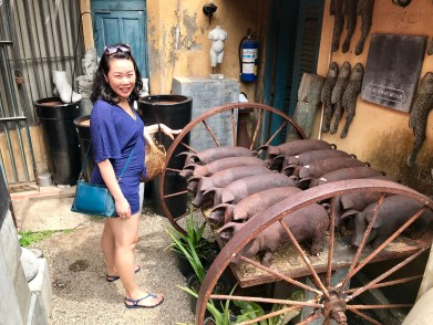 Anna and a wagon of metal pigs