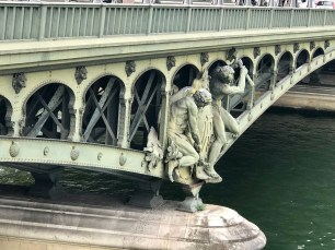 A closeup of the figures on the bridge