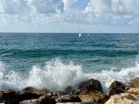 Waves crashing along the pier