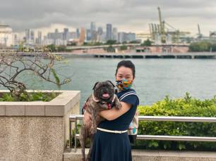 Anna struggling to lift our dog while posing at the port