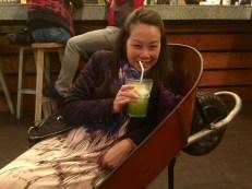 Anna drinking something green