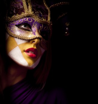 closeup portrait of sexy woman in violet party mask for desire concept