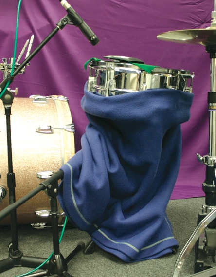 Fig. 5 Wrapping the bottom of the snare can help reduce bleed into the bottom mike.