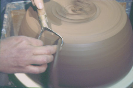"""Fig. 10: After drying, the shells are trimmed. """"This is where I shape the outside of the drum and establish a consistent thickness throughout the shell,"""" Wright says."""